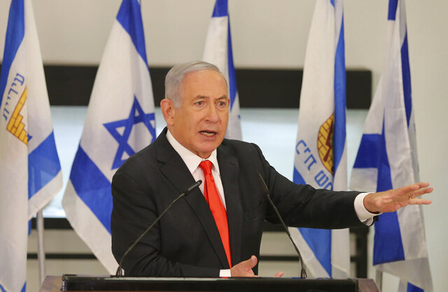 FILE - In this Sept. 8, 2020 file photo, Israeli Prime Minister Benjamin Netanyahu speaks during his visit to the Israeli city of Beit Shemesh, near Jerusalem. With Netanyahu lashing out at him nearly every day, Israel's attorney general is pressing the prime minister to sign a conflict-of-interest agreement that would bar him from influencing key appointments that could affect his corruption trial. (Alex Kolomoisky/Pool Photo via AP, File)
