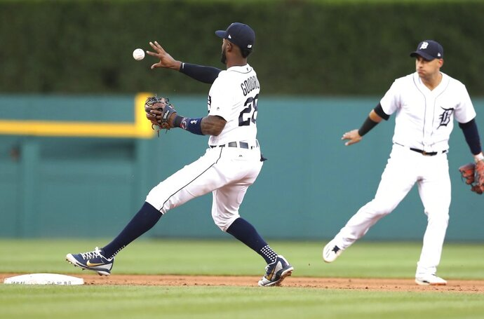 Detroit Tigers second baseman Niko Goodrum bare-hands the relay from shortstop Jose Iglesias, right, for a force on Minnesota Twins' Bobby Wilson on a ball hit by Eddie Rosario during the fifth inning of a baseball game,Wednesday, June 13, 2018, in Detroit. (AP Photo/Carlos Osorio)