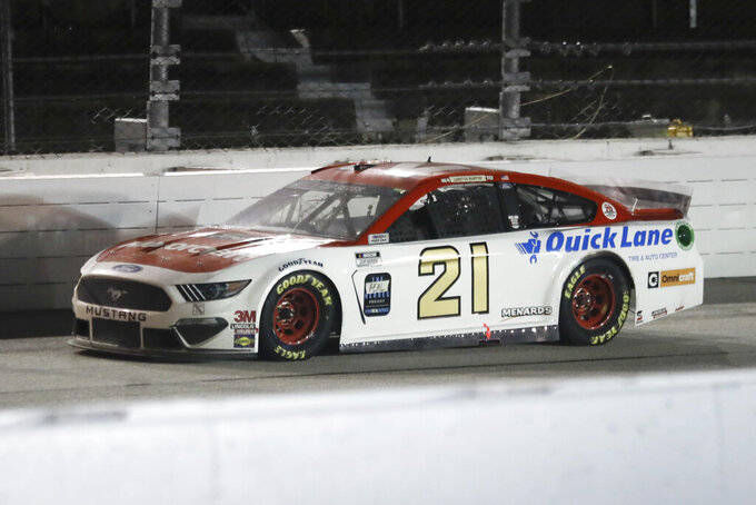 Matt DiBenedetto (21) drives during the NASCAR Cup Series auto race Wednesday, May 20, 2020, in Darlington, S.C. (AP Photo/Brynn Anderson)