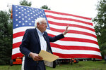 Democratic presidential candidate Sen. Bernie Sanders walks on stage to speak at the Polk County Democrats Steak Fry, Saturday, Sept. 21, 2019, in Des Moines, Iowa. (AP Photo/Charlie Neibergall)
