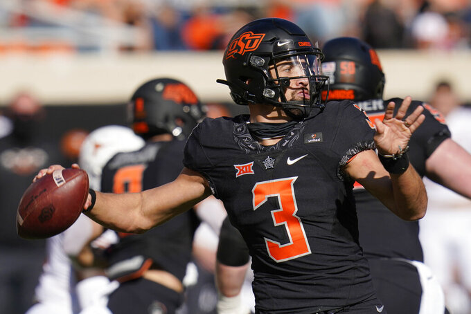 Oklahoma State quarterback Spencer Sanders (3) throws in the first half of an NCAA college football game against Texas in Stillwater, Okla., Saturday, Oct. 31, 2020. (AP Photo/Sue Ogrocki)