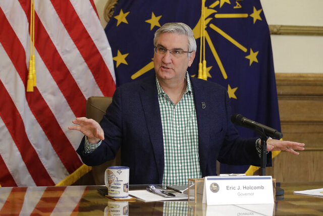 FILE - In this April 29, 2020, file photo, Indiana Gov. Eric Holcomb prepares to host a virtual media briefing in the Governor's Office at the Statehouse to provide updates on COVID-19 and its impact on Indiana, in Indianapolis. Gov. Holcomb's statewide mask mandate and six months of other coronavirus restrictions has stirred discontent among conservatives, complicating his front-runner campaign against underfunded Democratic challenger Woody Myers. (AP Photo/Darron Cummings, File)