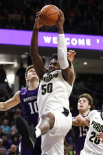 Purdue forward Trevion Williams (50) rebounds a ball against Northwestern forward Miller Kopp during the second half of an NCAA college basketball game in Evanston, Ill., Saturday, Feb. 1, 2020. (AP Photo/Nam Y. Huh)