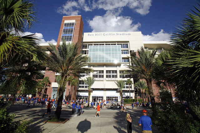FILE-This Saturday, Sept. 10, 2011 file photo shows the west exterior of Ben Hill Griffin Stadium at University of Florida, in Gainesville, Fla. The University of Florida has rescinded an admissions offer to a prospective student who posted a racist comment on social media. (AP Photo/John Raoux)