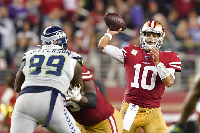 San Francisco 49ers quarterback Jimmy Garoppolo (10) passes against Seattle Seahawks defensive tackle Quinton Jefferson (99) during the second half of an NFL football game in Santa Clara, Calif., Monday, Nov. 11, 2019. (AP Photo/Tony Avelar)