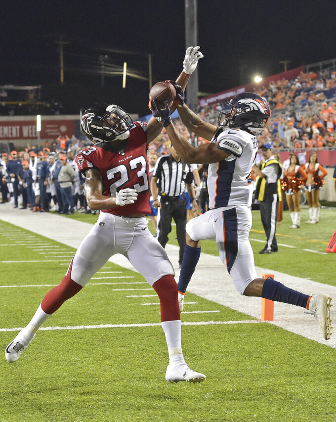 Denver Broncos wide receiver Trinity Benson (2) can't catch a pass under pressure from Atlanta Falcons defensive back Jayson Stanley (23) during the second half of the Pro Football Hall of Fame NFL preseason game Thursday, Aug. 1, 2019, in Canton, Ohio. The Broncos won 14-10. (AP Photo/David Richard)