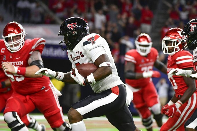 Texas Tech linebacker Riko Jeffers (6) returns an interception against Houston during the second half of an NCAA college football game Saturday, Sept. 4, 2021, in Houston. (AP Photo/Justin Rex)