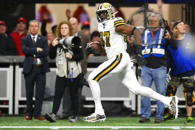 New Orleans Saints tight end Jared Cook (87) runs against the Atlanta Falcons during the first half of an NFL football game, Thursday, Nov. 28, 2019, in Atlanta. (AP Photo/John Amis)
