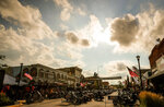 This Aug.  2019 photo shows motorcycles lining Main Street In Sturgis, S.D.  South Dakota, which has seen an uptick in coronavirus infections in recent weeks, is bracing to host hundreds of thousands of bikers for the 80th edition of the Sturgis Motorcycle Rally. More than 250,000 people are expected to attend the Aug. 7 to Aug. 16 rally in western South Dakota.  (Adam Fondren/Rapid City Journal via AP)