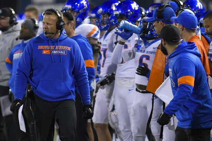 Boise State coach Bryan Harsin watches the team play Utah State during the first half of an NCAA college football game Saturday, Nov. 23, 2019, in Logan, Utah. (AP Photo/Eli Lucero)