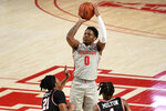Houston guard Marcus Sasser (0) shoots as Western Kentucky guards Kenny Cooper (21) and Kylen Milton defend during the second half of an NCAA college basketball game, Thursday, Feb. 25, 2021, in Houston. (AP Photo/Eric Christian Smith)