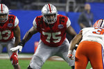 File-This Dec. 28, 2019, file photo shows Ohio State offensive lineman Thayer Munford (75) during the first half of the Fiesta Bowl NCAA college football game against Clemson in Glendale, Ariz. First-team All-Big Ten offensive tackle Munford, is returning for an extra year of eligibility. (AP Photo/Rick Scuteri, File)