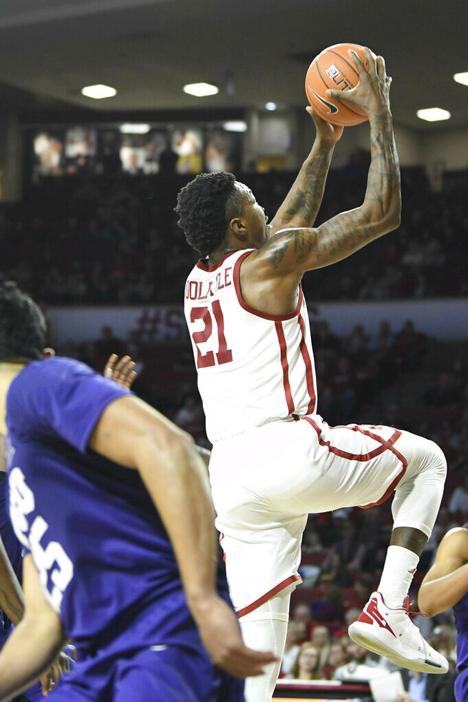 No. 23 Oklahoma tops No. 25 TCU 76-74 on Doolittle's shot