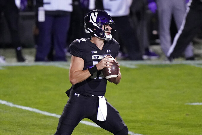 Northwestern quarterback Peyton Ramsey looks to throw a pass against Maryland during the first half of an NCAA college football game in Evanston, Ill., Saturday, Oct. 24, 2020. (AP Photo/Nam Y. Huh)