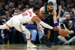 Houston Rockets' Russell Westbrook (0) and Boston Celtics' Jayson Tatum reach for the ball during the second half of an NBA basketball game in Boston, Saturday, Feb. 29, 2020. (AP Photo/Michael Dwyer)