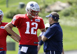 New England Patriots quarterback Tom Brady (12) speaks with head coach Bill Belichick, right, during NFL football practice, Wednesday, Sept. 11, 2019, in Foxborough, Mass. (AP Photo/Steven Senne)
