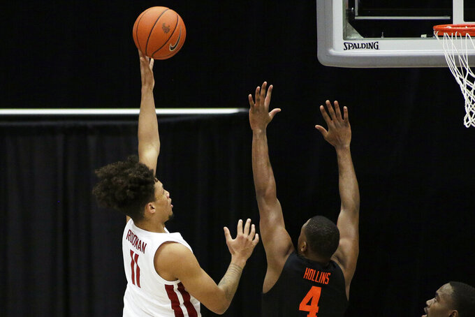Washington State forward DJ Rodman (11) shoots over Oregon State forward Alfred Hollins (4) during the second half of an NCAA college basketball game in Pullman, Wash., Wednesday, Dec. 2, 2020. Washington State won 59-55. (AP Photo/Young Kwak)