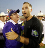 FILE - In this Sept. 26, 2015, file photo, Texas Tech head coach Kliff Kingsbury, right, shakes hands hands with TCU head coach Gary Patterson after TCU won 55-52 in an NCAA college football game in Lubbock, Texas. TCU defensive guru Gary Patterson and Texas Tech offensive mastermind Kliff Kingsbury both express admiration for how the other coach excels at his specialty. (AP Photo/LM Otero, File)