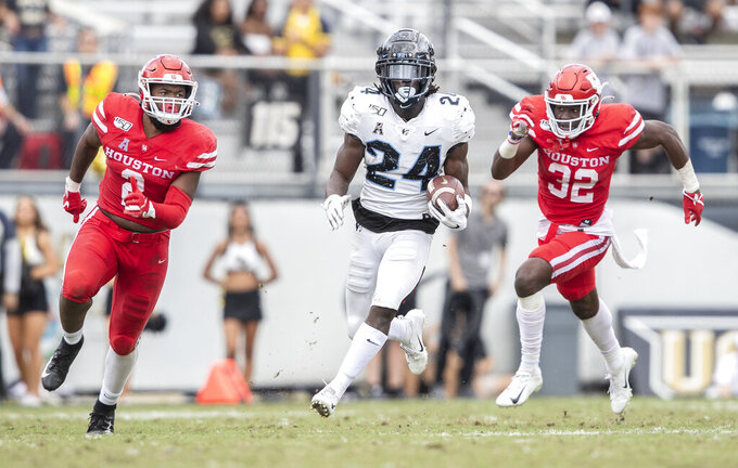 Central Florida running back Bentavious Thompson (24) is chased by Houston safeties Deontay Anderson (2) and Gervarrius Owens (32) during the second half of an NCAA college football game in Orlando, Fla., Saturday, Nov. 2, 2019. (Photo/Willie J. Allen Jr.)