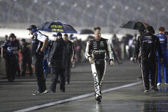 Jeb Burton (10) leaves pit road during a rain delay in a NASCAR Xfinity Series auto race at Daytona International Speedway, Friday, Aug. 27, 2021, in Daytona Beach, Fla. (AP Photo/Phelan M. Ebenhack)