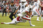 Auburn receiver Anthony Schwartz is tackled just short of the goal line by Arkansas defender Kamren Curl during the first half of an NCAA college football game, Saturday, Oct. 19, 2019 in Fayetteville, Ark. (AP Photo/Michael Woods)