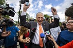 Senate Majority Leader Chuck Schumer of N.Y., center, celebrates with Deferred Action for Childhood Arrivals (DACA) recipients and supporters in front of the Supreme Court on Thursday, June 18, 2020, in Washington. The Supreme Court on Thursday rejected President Donald Trump's effort to end legal protections for 650,000 young immigrants, a stunning rebuke to the president in the midst of his reelection campaign. (AP Photo/Manuel Balce Ceneta)
