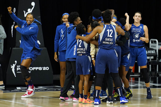 The Minnesota Lynx celebrate their win over the Phoenix Mercury during a WNBA playoff basketball game Thursday, Sept. 17, 2020, in Bradenton, Fla. (AP Photo/Chris O'Meara)