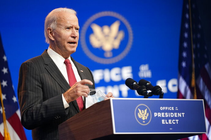 FILE - In this Nov. 19, 2020, file photo President-elect Joe Biden speaks at The Queen theater in Wilmington, Del. (AP Photo/Andrew Harnik, File)
