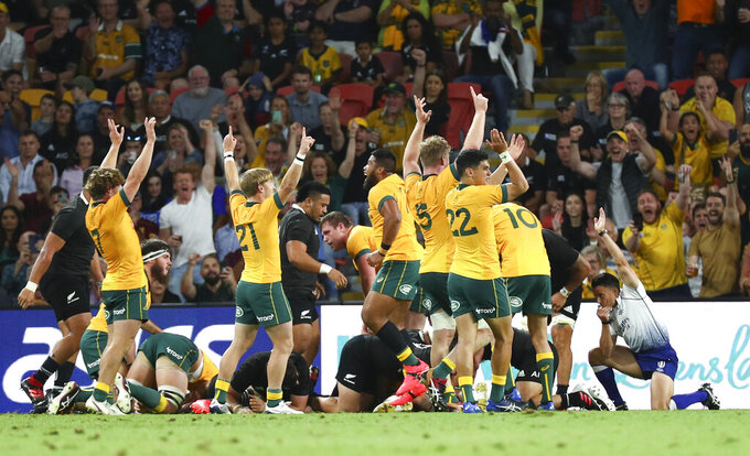 Referee Nick Berry, right, awards a try to Australia during the Bledisloe rugby test between Australia and New Zealand at Suncorp Stadium, Brisbane, Australia, Saturday, Nov.7, 2020. (AP Photo/Tertius Pickard)