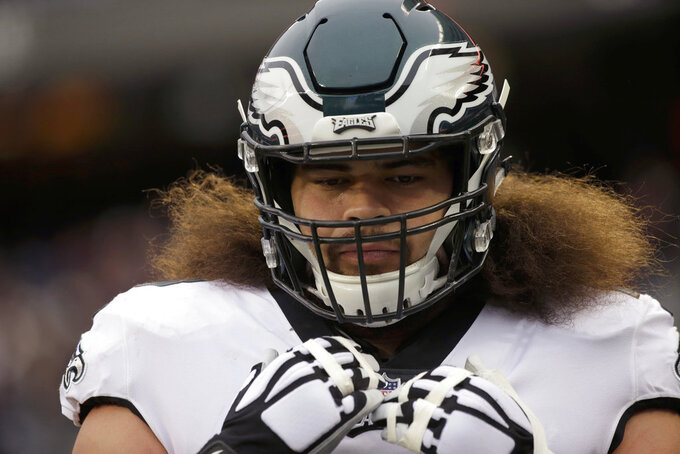 Philadelphia Eagles offensive guard Isaac Seumalo (73) warms up before an NFL wild-card playoff football game against the Chicago Bears Sunday, Jan. 6, 2019, in Chicago. (AP Photo/David Banks)