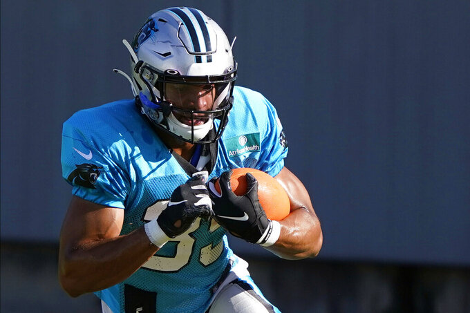 FILE - In this Aug. 18, 2020, file photo, Carolina Panthers running back Reggie Bonnafon carries the ball during NFL football camp in Charlotte, N.C. The Panthers waived Bonnafon as part of several moves to get down to 53 players on Saturday, Sept. 5, 2020. Bonnafon ran for 116 yards with a touchdown in 16 games last year and played a major role on special teams. (AP Photo/Chris Carlson, File)