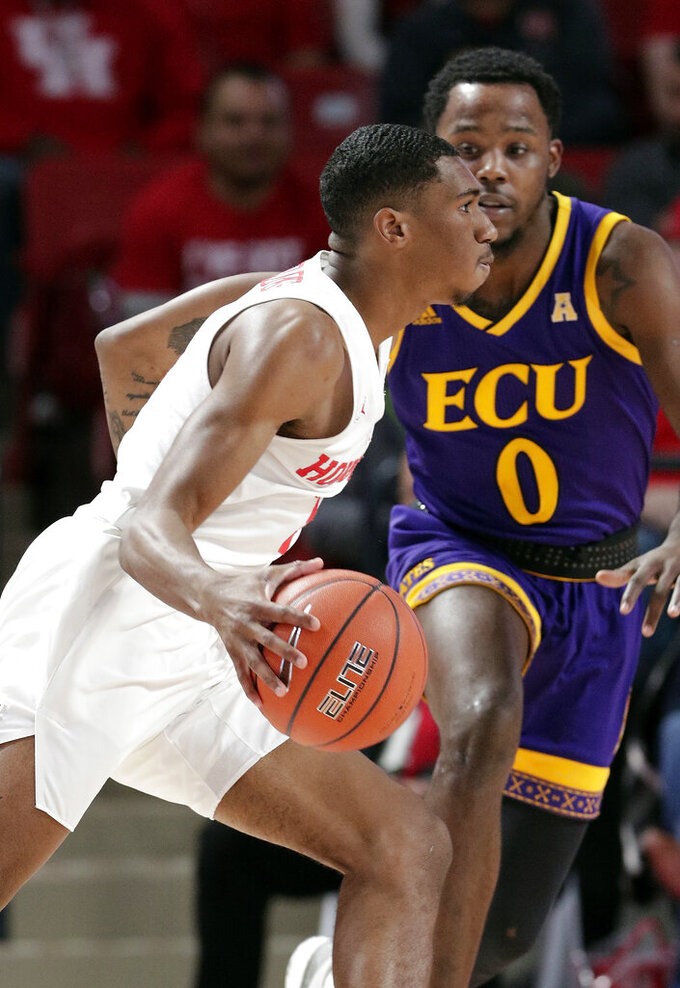 Houston guard Armoni Brooks, left, drives around East Carolina guard Isaac Fleming (0) during the first half of an NCAA college basketball game Wednesday, Jan. 23, 2019, in Houston. (AP Photo/Michael Wyke)