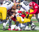 Iowa running back Toren Young (28) battles with the Indiana defense as he rushes the ball out of the backfield during the second half of an NCAA college football game Saturday, Oct. 13, 2018, in Bloomington, Ind. Iowa won 42-16. (AP Photo/Doug McSchooler)