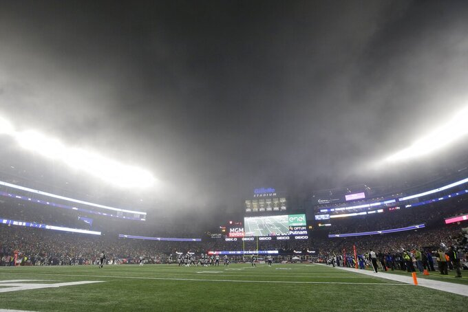 Fog hovers over the field in the first half of an NFL wild-card playoff football game between the New England Patriots and the Tennessee Titans, Saturday, Jan. 4, 2020, in Foxborough, Mass. (AP Photo/Steven Senne)