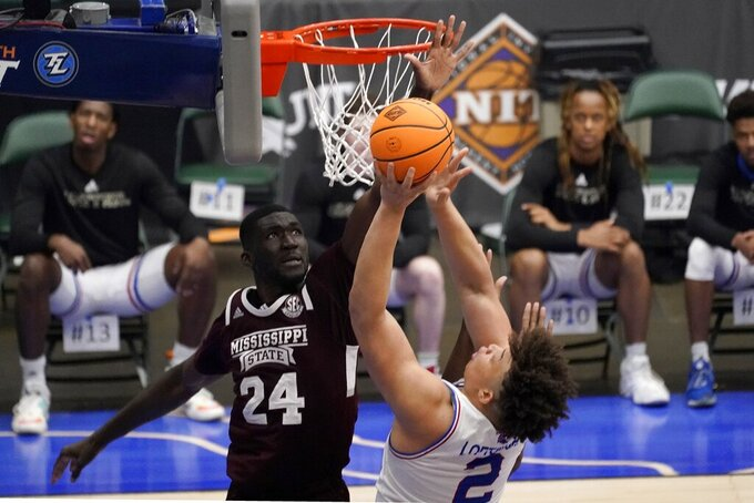 Mississippi State forward Abdul Ado (24) blocks a shot attempt by Louisiana Tech forward Kenneth Lofton Jr. (2) in the second half of an NCAA college basketball game in the semifinals of the NIT, Saturday, March 27, 2021, in Frisco, Texas. (AP Photo/Tony Gutierrez)