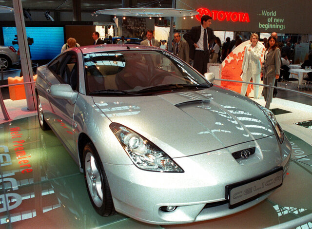 FILE - In this Sept. 14, 1999, file photo Japanese car builder Toyota displays their latest version of the Celica at the Frankfurt international car fair, IAA. Toyota is recalling 361,000 more vehicles worldwide to replace Takata air bag inflators that could explode and hurl shrapnel. The recall covers gas and electric versions of the RAV4 SUV and the Celica sports car from 1997 to 1999.  (AP Photo/Bernd Kammerer, File)