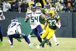 Green Bay Packers' Aaron Jones runs during the first half of an NFL divisional playoff football game against the Seattle Seahawks Sunday, Jan. 12, 2020, in Green Bay, Wis. (AP Photo/Mike Roemer)