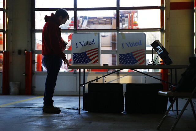 A voter casts a ballot in the South Carolina primary election, Saturday, Feb. 29, 2020, in Columbia, S.C. (AP Photo/Matt Rourke)
