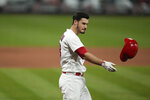 St. Louis Cardinals' Nolan Arenado tosses his helmet after striking out to end the eighth inning of a baseball game against the Cincinnati Reds Friday, June 4, 2021, in St. Louis. (AP Photo/Jeff Roberson)