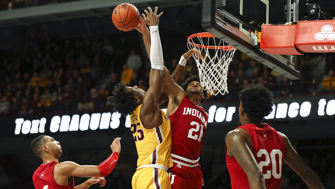 Indiana's Jerome Hunter knocks the ball away from Minnesota's Daniel Oturu during the first half of an NCAA college basketball game Wednesday, Feb. 19, 2020, in Minneapolis. (AP Photo/Stacy Bengs)