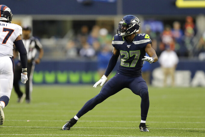Seattle Seahawks defensive back Marquise Blair watches a Denver Broncos play develop during the first half of an NFL football preseason game Thursday, Aug. 8, 2019, in Seattle. (AP Photo/Stephen Brashear)