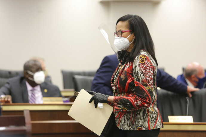 South Carolina Sen. Mia McLeod, D-Columbia, walks to her seat as the South Carolina Senate Medical Affairs meets on Thursday, Jan. 21, 2021 in Columbia, S.C. The committee approved a stricter ban on abortions. (AP Photo/Jeffrey Collins)