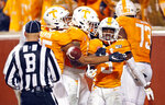 Tennessee running back Eric Gray (3) celebrates with tight end Dominick Wood-Anderson (4) and wide receiver Cedric Tillman (85) after running for a 94-yard touchdown in the first half of an NCAA college football game Saturday, Nov. 30, 2019, in Knoxville, Tenn. (AP Photo/Wade Payne)