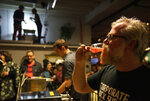 In this photo taken on Saturday, Feb. 23, 2019, brewer Sigurdur Snorrason drinks a craft beer at a festival in Reykjavik. Icelanders are celebrating the end, three decades ago, of a sobering dry spell in their country's history. On Friday, March 1 the country toasts the anniversary of the lifting of a decades-long ban on beer with _ what else? _ a nationwide Beer Day. (AP Photo/Egill Bjarnason)