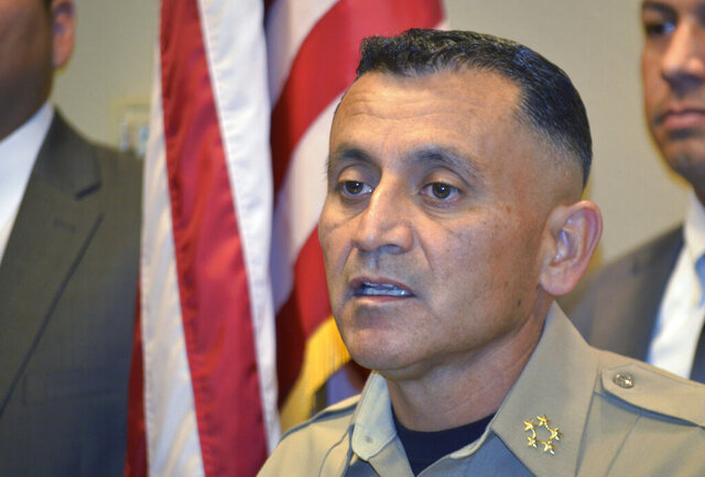 FILE - In this Nov. 28, 2017, file photo, Bernalillo County Sheriff Manuel Gonzales speaks at a news conference in Albuquerque, N.M., after another one of his deputies was involved in a shooting. Gonzales said Wednesday, July 15, 2020, he is looking to partner with a company so deputies can put smartphones in their vests and record video instead of using body cameras. (AP Photo/Russell Contreras, File)