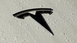 This Oct. 18, 2019, photo shows a Tesla logo in Salt Lake City. Tesla reports financial earns on Wednesday, Oct. 23. (AP Photo/Rick Bowmer)