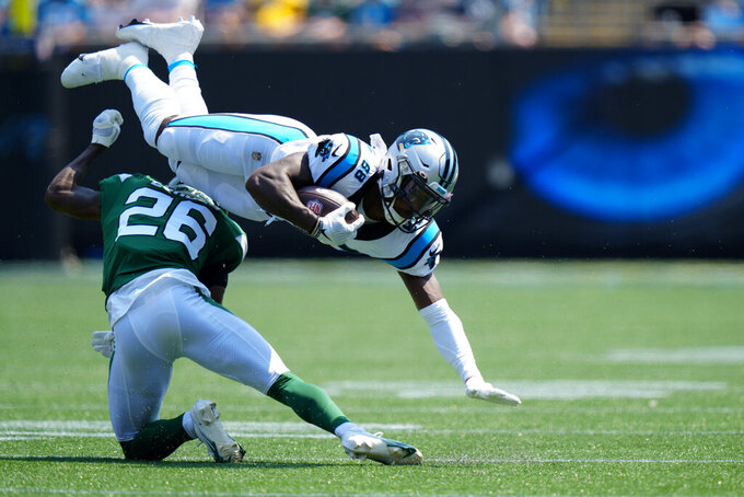 Carolina Panthers wide receiver Terrace Marshall Jr. is tackled by New York Jets cornerback Brandin Echols during the first half of an NFL football game Sunday, Sept. 12, 2021, in Charlotte, N.C. (AP Photo/Jacob Kupferman)
