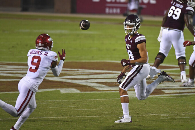 Mississippi State wide receiver Cameron Gardner (18) watches as Arkansas defensive back Greg Brooks Jr. (9) intercepts a pass during the first half of an NCAA college football game in Starkville, Miss., Saturday, Oct. 3, 2020. (AP Photo/Thomas Graning)