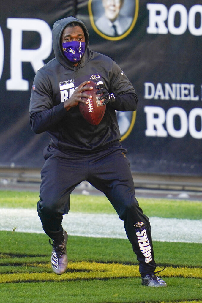Baltimore Ravens quarterback Robert Griffin III (3) warms up before an NFL football game against the Pittsburgh Steelers, Wednesday, Dec. 2, 2020, in Pittsburgh. (AP Photo/Gene J. Puskar)