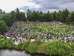 People gather in the Lilac Bowl at Riverfront Park in Spokane, Wash., Sunday, June 7, 2020, for a Black Lives Matter rally, sparked by the death of George Floyd, who died May 25 after being restrained by police in Minneapolis. (Jesse Tinsley/The Spokesman-Review via AP)